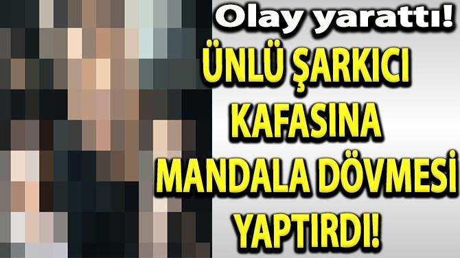 ÜNLÜ ŞARKICI KAFASINA MANDALA DÖVMESİ YAPTIRDI!