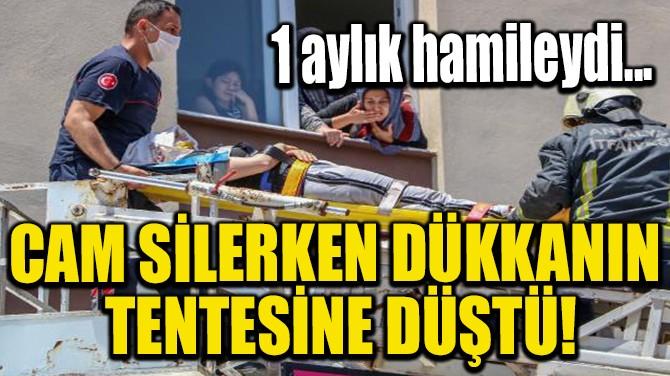 CAM SİLERKEN DÜKKANIN TENTESİNE DÜŞTÜ!